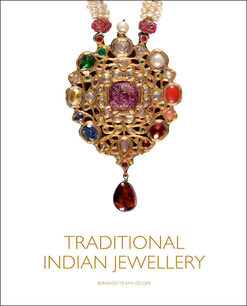 Photograph of a traditional Indian gold necklace decorated with gems and beads hanging on a white background with gold font title Traditional Indian Jewellery underneath