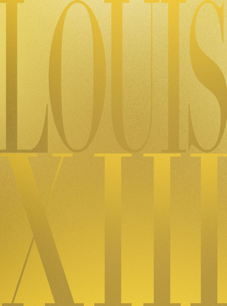 Shiny glittery gold front cover with cognac title LOUIS XIII in fading dark to light gold lettering covering full page